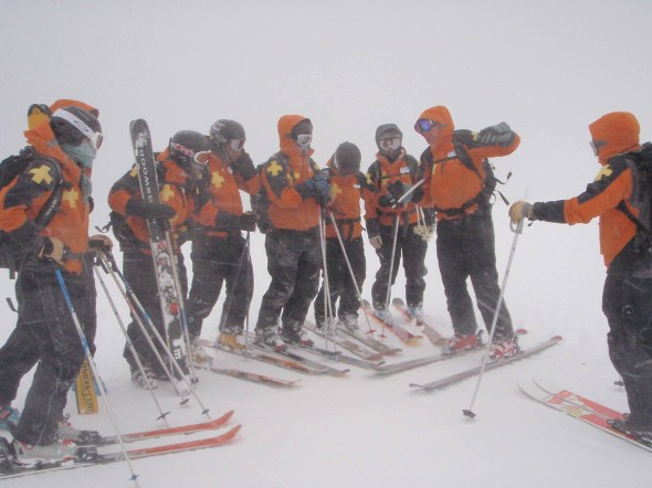 Control teams discuss plan of attack at the top of Paradise chair.