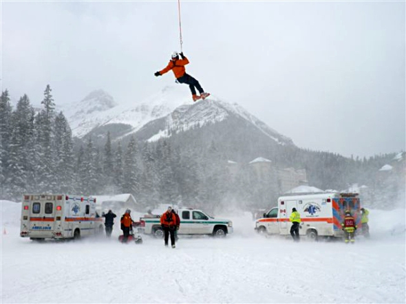 Ambulances wait near the Fairmont Chateau Lake Louise  (photo: Brian Webster)